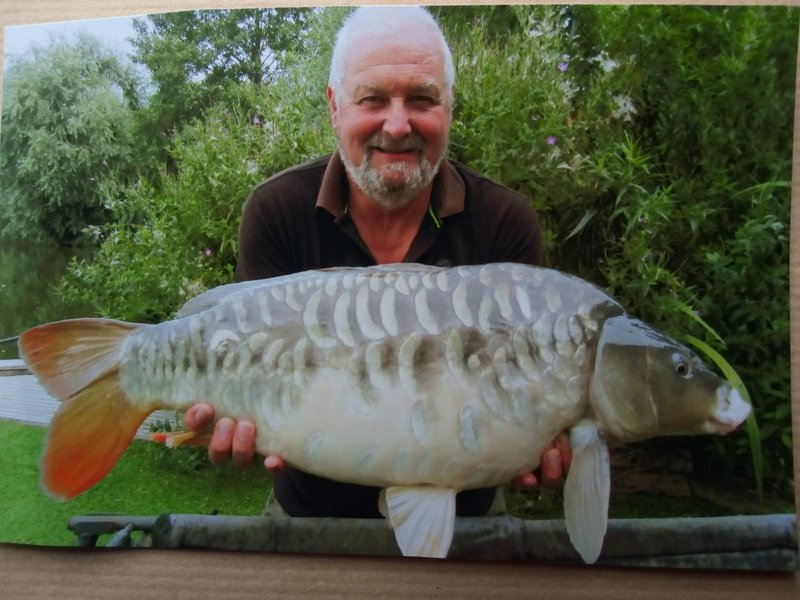 Brian Round with a stunning 21lb heavily scalled Cherry Springs Mirror