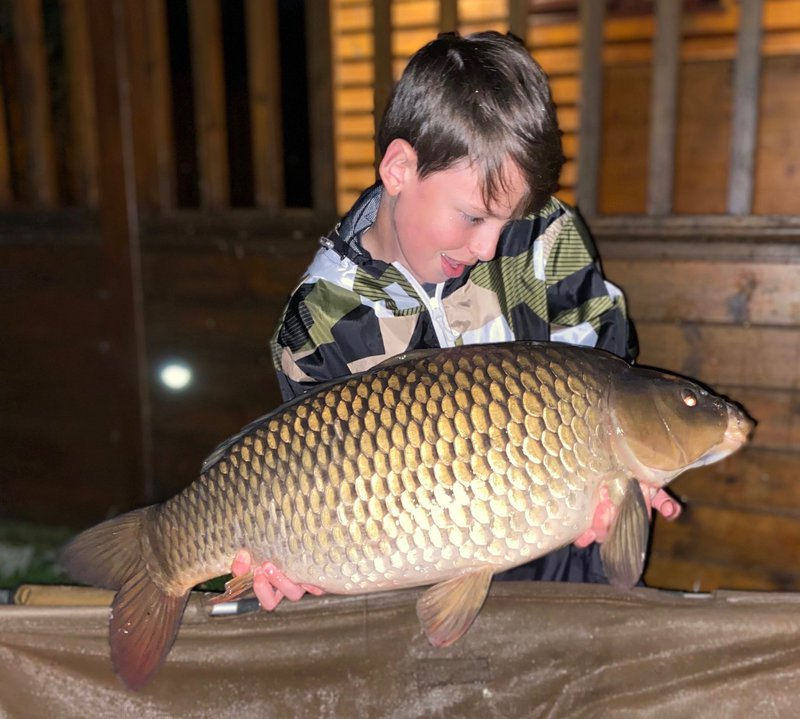 Sam with one of two 20lb+ Commons. This one weighed 20-04