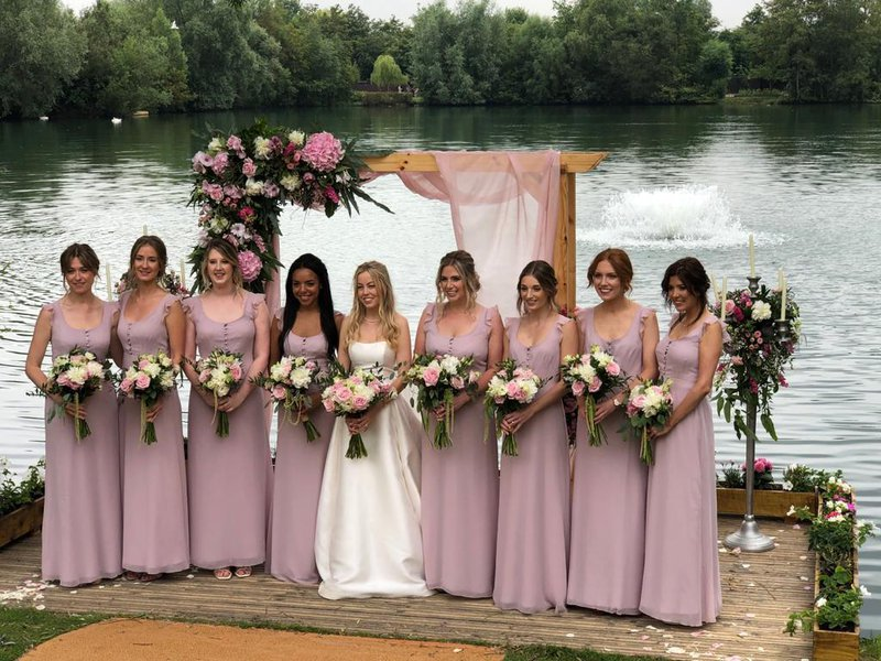 So many beautiful bridesmaids with a beautiful bride.