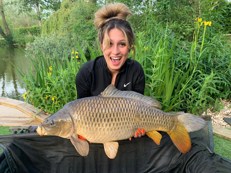 Roxanne with a 21lb Common landed from Kingfisher Lodge