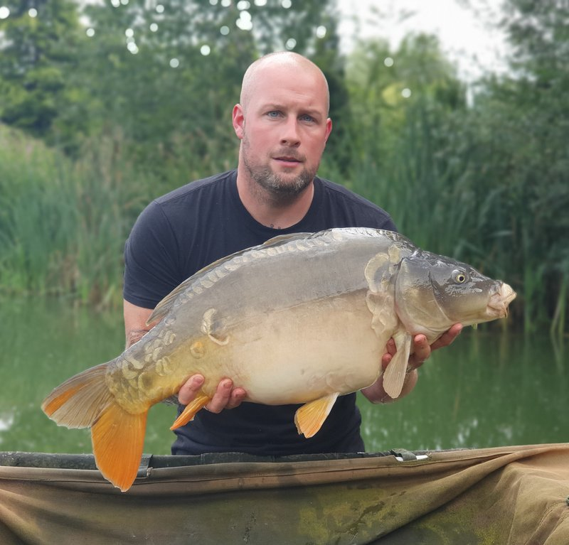 Tony Barden with a 23lb Cherry Mere Mirror. the biggest of his visit.