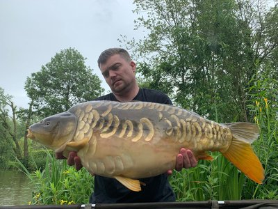 Dean Knott with a stunning 25lb Mirror from Cherry Springs