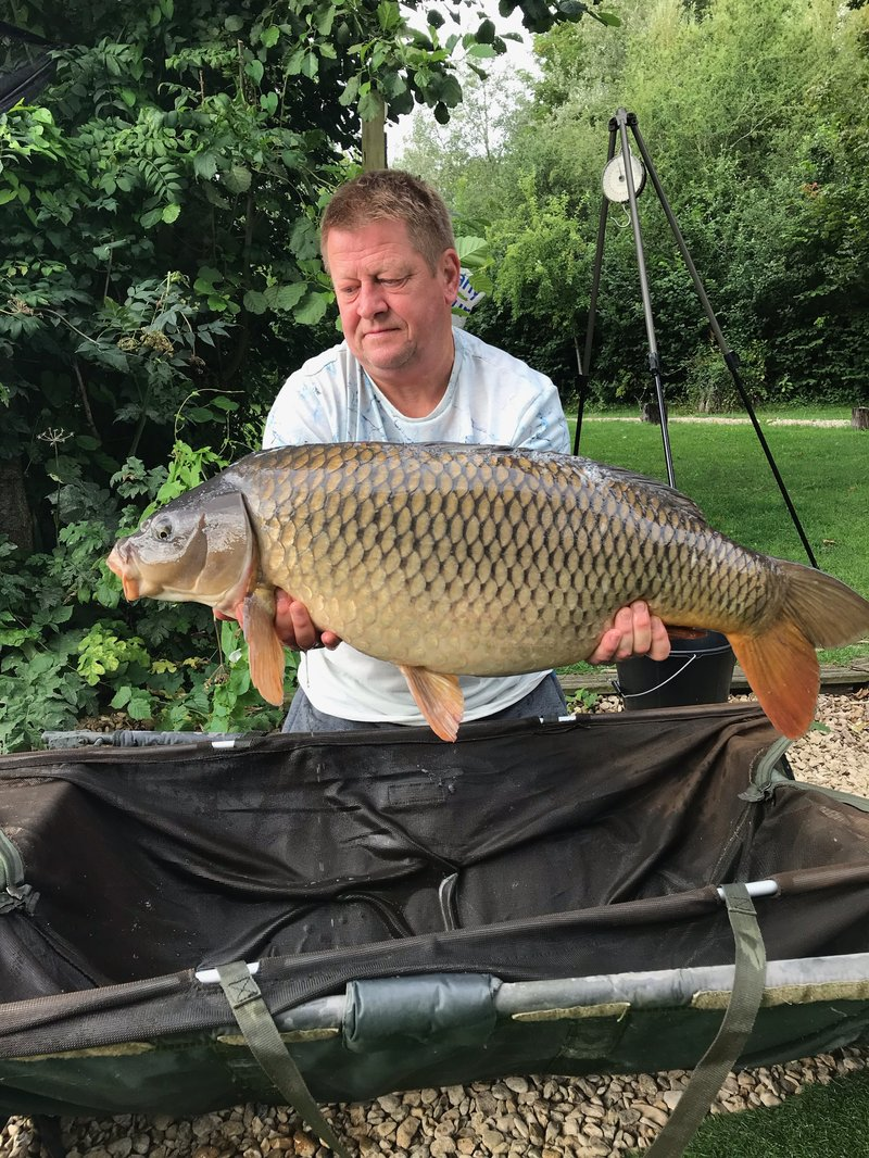 Lee Pearce with a lovely 29-02 Cherry Lake Common from the Cottage swim