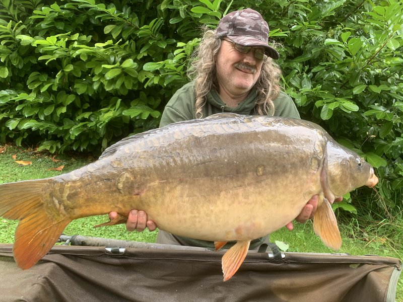 Paul Mitchell with a 35-04 Mirror from Cherry Lake Cottage