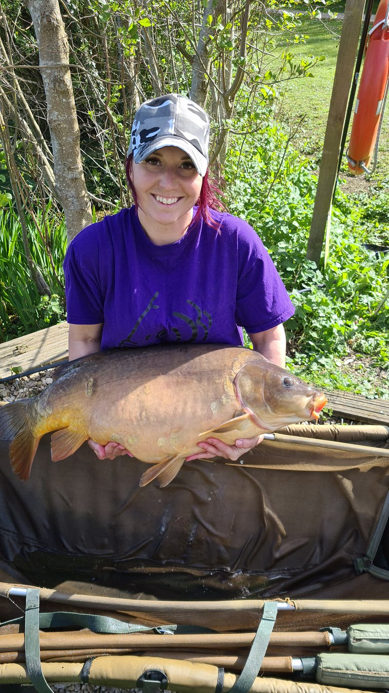 Charlotte Hull with her PB. A 35lb carp caught from the Cottage swim.