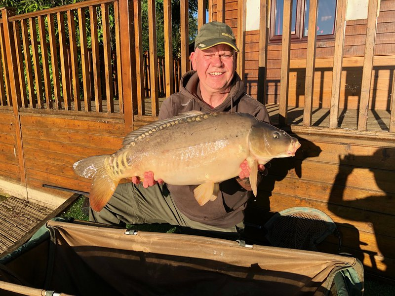 Adrian Bates with the biggest of two twenties, A 26-09 Mirror from Cherry Mere.