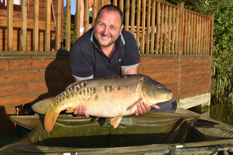 Alan Burford with his new PB. a 32-04 Mirror taken whilst staying in Pochard Lodge on Cherry Mere