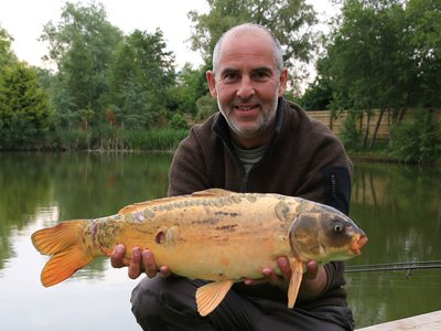Andrew Wells with a Koi of 11lb from Cherry Pool..jpg