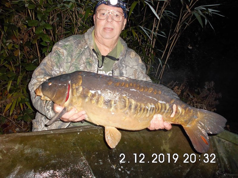 Peter WEbster with a lean 'Cotswolds' classic looking Carp of 18-03 from Cherry Pool