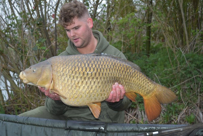Joe Baker with the same Common Carp in April at 30-08