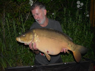 Roger Sparks. 32-04 Mirror from Heron Lodge caught during his May visit.