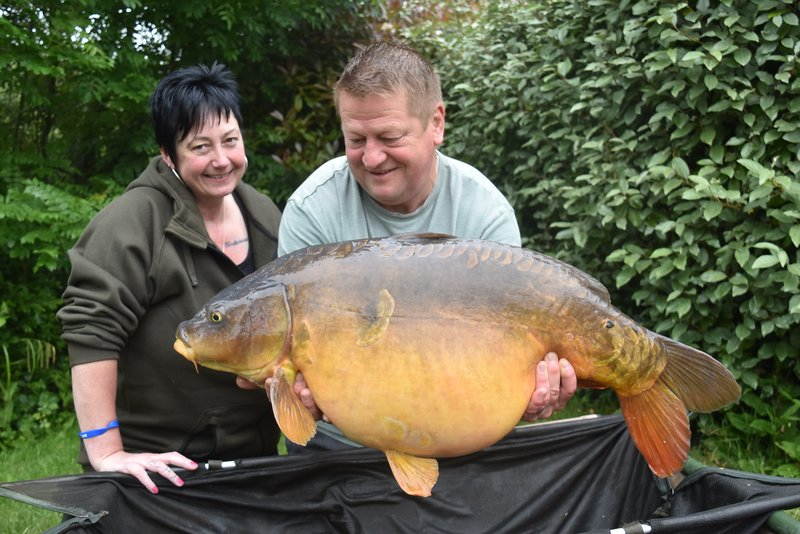 Teri Brebner with her 35-08 Cherry Lake Mirror held by Lee Pearce
