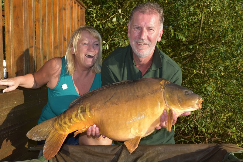 Roger and Suzanne Sparks with his new PB. A 33-08 Mirror.