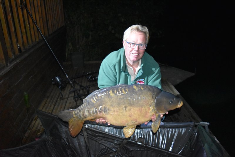 Mike holding Gary Sullivan's 30-12 Mirror Carp from Grebe Lodge