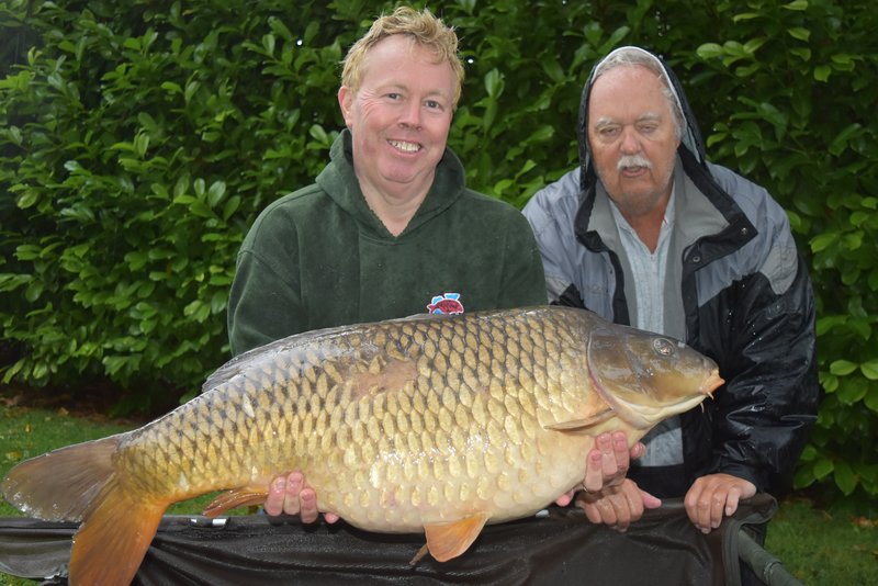 John Davies with the 'Scruff' Common at 38-04 from Cherry Lake Cottage, held by Mike