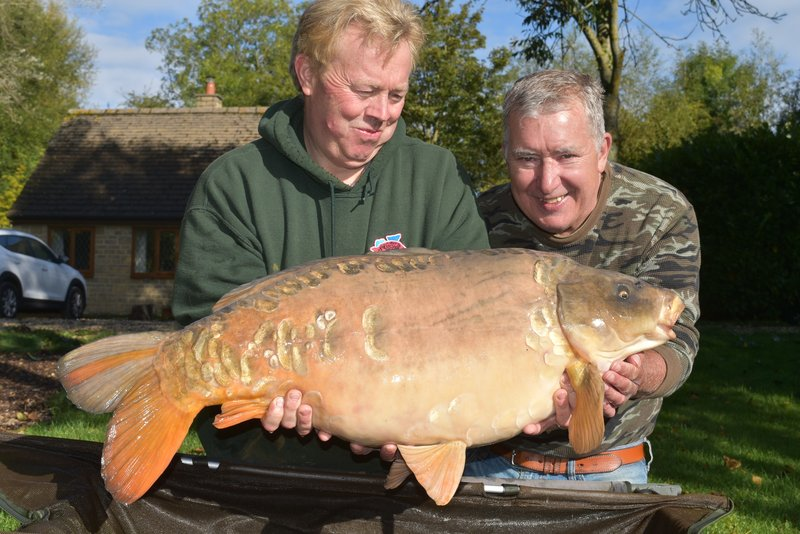 Peter Davies was delighted with his new PB, this 37-02 Ghost Mirror from Cherry Lake Cottage. Mike helped with the posing!