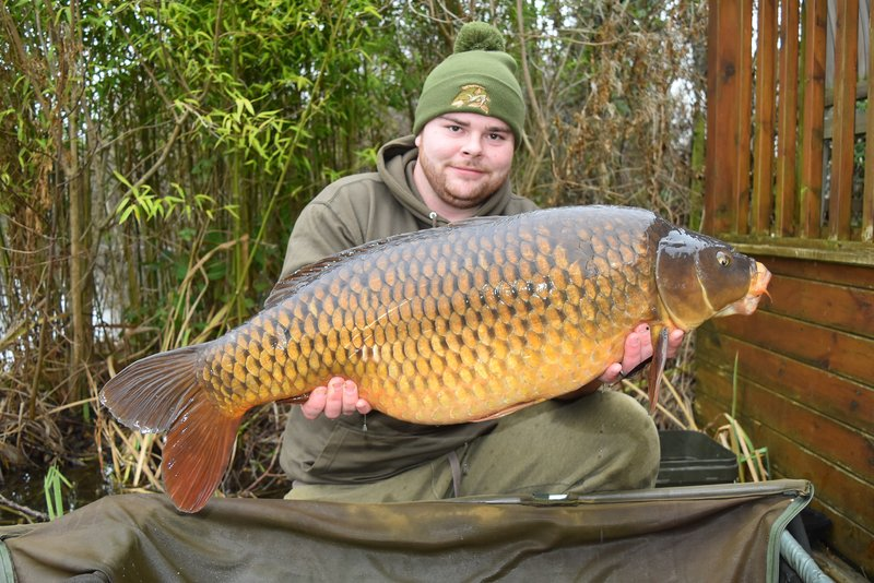 Ryan Young with a cracking 29-04 Common Carp from Osprey Lodge on Cherry Lake