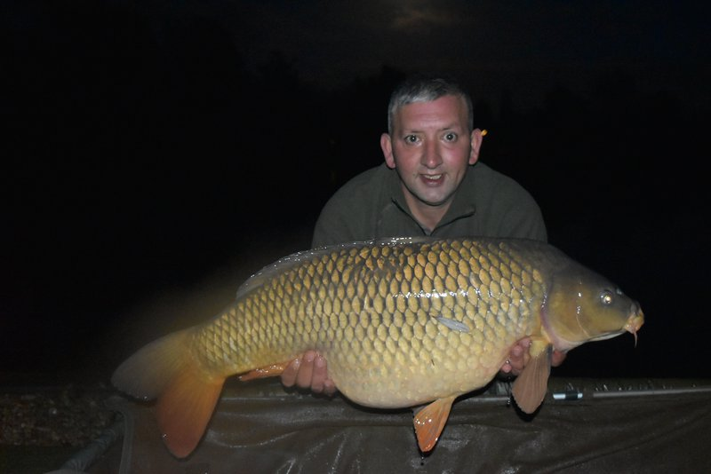 Mark Denmark with his second PB in a day. A 35-12 Common from Cherry Lake Cottage.