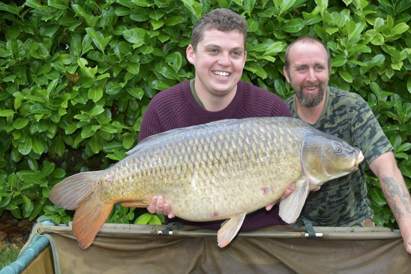 John Furnley with a 37-12 Common caught from the Cottage swim,  held by Luke Williams