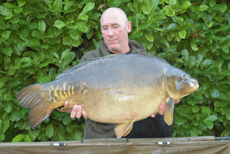 Wayne Poole with our latest new forty. A 40-04 Mirror from the Cottage swim.