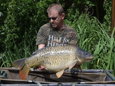 Neil with a 29-10 Fully Scaled Mirror. What a fish!