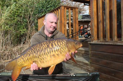Dave with a 23-08 Mirror Carp from Cherry Lake. He has the best job in the world!.jpg