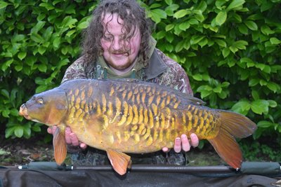David Carter was very pleased with this heavily scaled Cherry Lake Mirror of 23lb from the Cottage swim..jpg