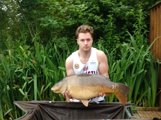 Harrison  Booth with his 27-08 Mirror Carp  PB  from Osprey Lodge