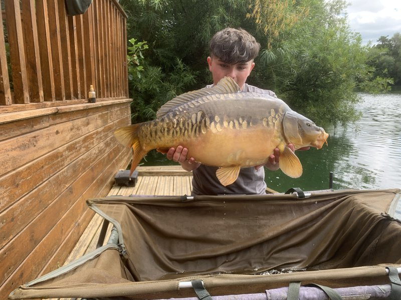Tom with a mint 24lb+ Mirror from Osprey Lodge.