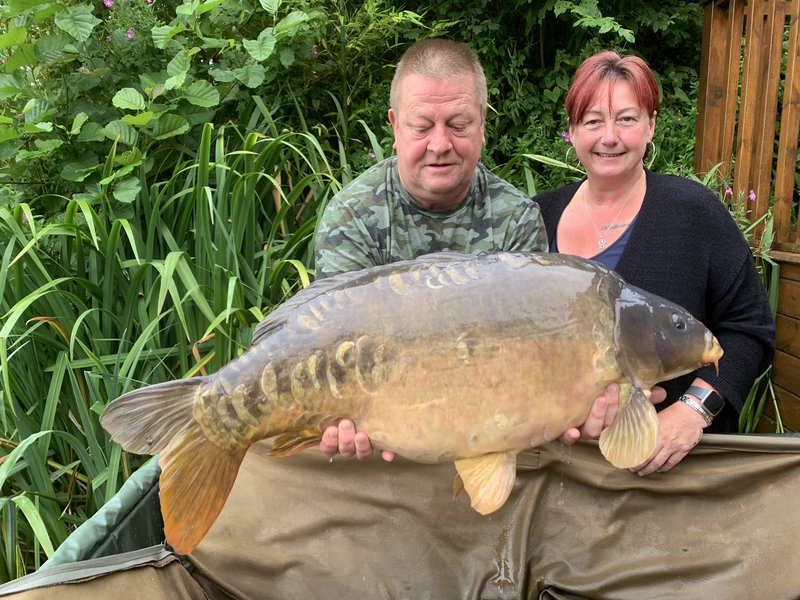 Teri Brebner with her 31-08 Mirror held by partner Lee Pearce.