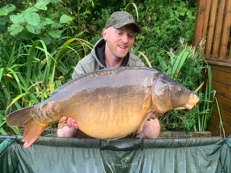 Chris Tibble with his new PB. A 30-02 Mirror from Osprey Lodge