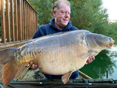 Charlie England with the new Cherry Lake record. 'Dick' at 49-12