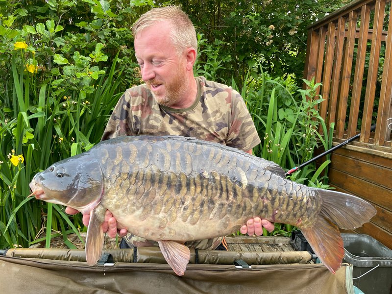 Chris Pollock with an attractive almost fully scale Mirror of 32lb