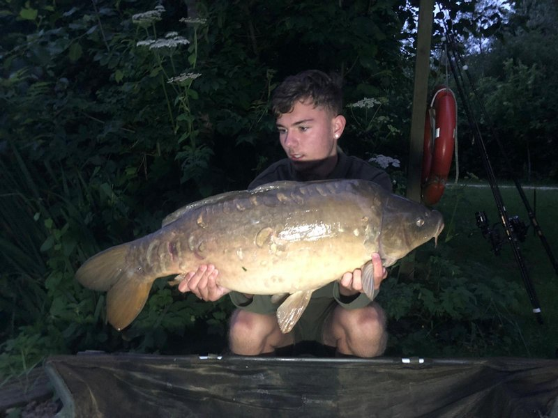 Jake Sayer with his biggest of 4 Carp. A 25-04 mirror from Cherry Lake Cottage