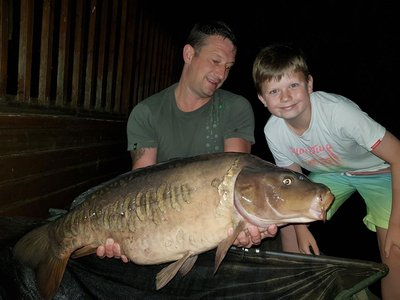 Matt Howgate aided by son Luke, with a 28-04 Mirror from Osprey Lodge