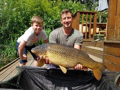 Matt and Luke Howgate with a mint 24-02 Cherry Lake Common