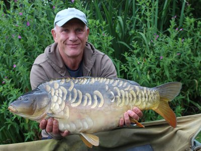 Neil Flack with a lovely 22lb Mirror from Cherry Springs.JPG