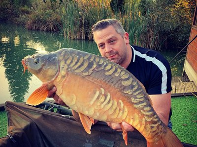 Neil Rowe with a beautiful Mirror Carp from Cherry Mere