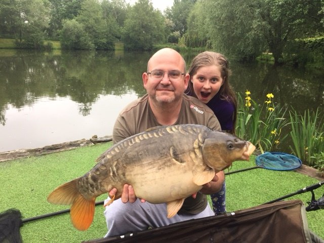Stephen Clark with the biggest of 26 Carp, a 21-04 Mirror from Cherry Springs..JPG