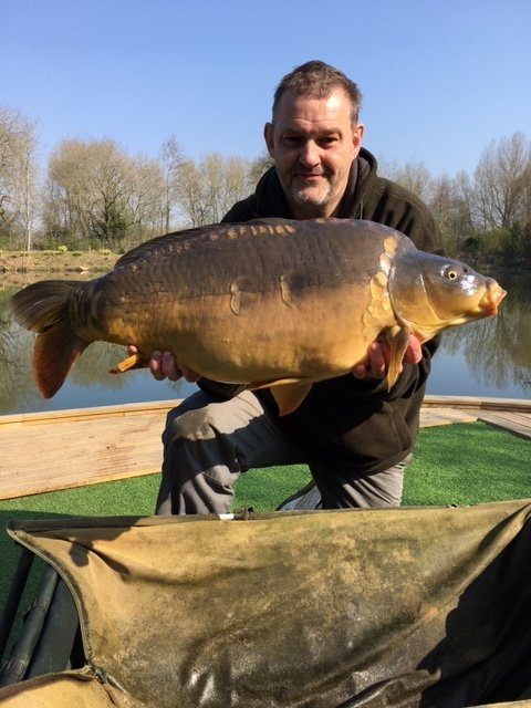 Stephen Lawrence with a 24-10 Mirror Carp. The first of an impressive brace of 20's from Kingfisher Lodge Cherry Springs.